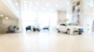 abstract blurred photo of lease vehicle showroom