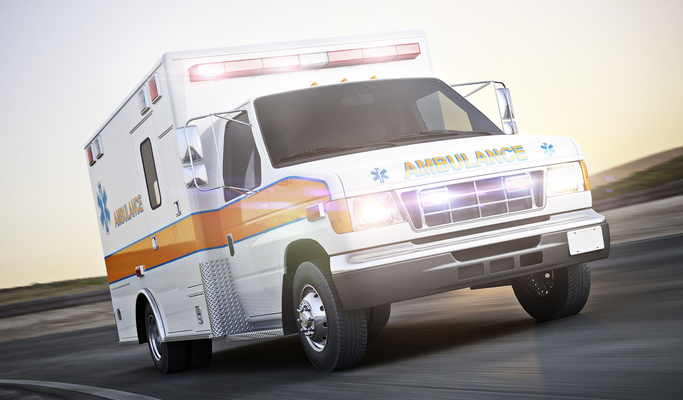 ambulance running with lights and sirens on a street with motion blur. photo realistic 3d model scene.